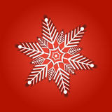 Snowflake from white paper on a color background Royalty Free Stock Image