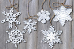 Snowflake  on  wood background Royalty Free Stock Photo