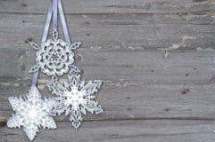 Snowflake  on  wood background Royalty Free Stock Photos