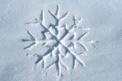 Snowflake written in snow Royalty Free Stock Image