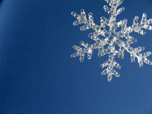 Snowflake4. Crystal snowflake against blue background Royalty Free Stock Images