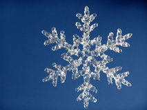 Snowflake5. Clear crystal snowflake against blue background Stock Image
