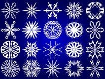 Snowflakes. White  snowflakes on a blue background Stock Image