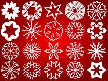 Snowflakes. White  snowflakes on a red background Royalty Free Stock Photos