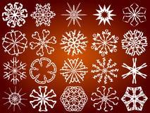 Snowflakes. White  snowflakes on a brown background Stock Photography