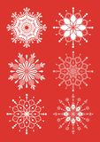 Snowflakes. These are freakish openwork snowflakes isolated on red background Royalty Free Stock Photography