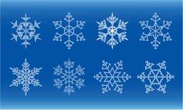 Snowflakes. Different white snowflakes on blue background Royalty Free Stock Photos