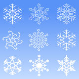 Snowflakes. 9 Snowflakes on blue background vector illustration