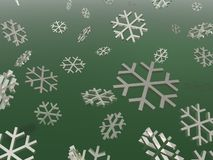 Snowflakes. Chrome snowflakes over a green background Royalty Free Stock Photography