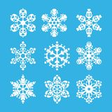 Snowflakes. On a blue background for the design Royalty Free Stock Images