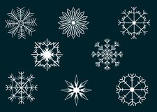 Snowflakes. Illustration of different kind of snowflakes with dark blue background Stock Photos