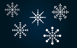 Snowflakes. Vector snowflakes set on a blue background Stock Images
