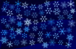 Snowflakes. Abstract image of snowflakes over blue and black background Royalty Free Stock Photography