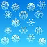 Snowflakes. 16 snowflakes on blue background Royalty Free Illustration