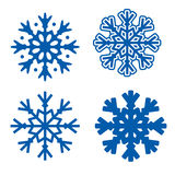 Snowflakes. Four blue snowflakes isolated over white background  illustration Stock Photos