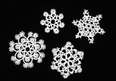 Snowflakes. Tatted snowflakes isolated on black Royalty Free Stock Image