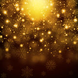 Snowflakes on abstract gold background Royalty Free Stock Images