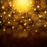 Snowflakes on abstract gold background Stock Photography