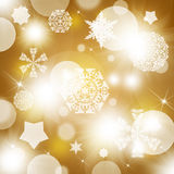Snowflakes on abstract gold background Royalty Free Stock Photo