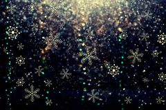 Snowflakes on an abstract shiny light background royalty free stock photos