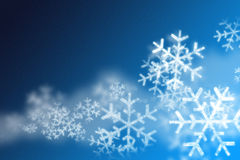 Snowflakes background. Blue background with snowflakes and snow Stock Photo