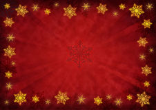Snowflakes background. Golden snowflakes on a grunge red background Royalty Free Stock Image