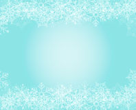 Snowflakes background. Christmas template in light blue/turquoise with white snowflakes on top and bottom, it can be used as a background or as a template, as it Royalty Free Stock Images