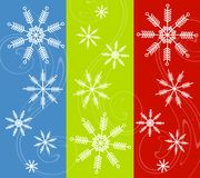 Snowflakes Background Designs. A background pattern featuring 3 festive colored panels with wisps of winter wind and snowflakes in white Stock Images