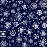 Snowflakes background in different shapes and sizes. Vector illustrations Royalty Free Stock Images