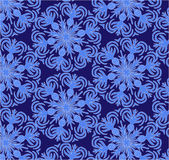 Snowflakes background vector. Snowflakes on a blue background Royalty Free Stock Photo