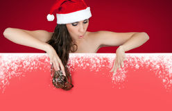 Snowflakes, billboard and santa girl Stock Photos