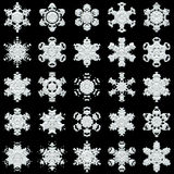 25 snowflakes on black background. 25 white different snowflakes on black background - good image for a christmas, new year and winter themes Royalty Free Stock Image