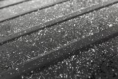 Snowflakes on a black car as a background.  Royalty Free Stock Photos