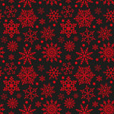 Snowflakes on black and red background seamless texture Stock Photography