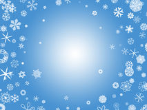 Snowflakes - blue. White snowflakes on a blue background Stock Photo