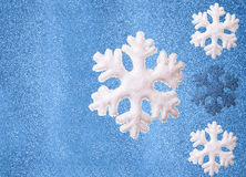 Snowflakes on a blue background Royalty Free Stock Images