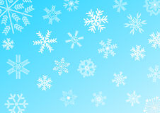Snowflakes on blue background Royalty Free Stock Images