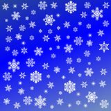 Snowflakes on blue background Royalty Free Stock Photography