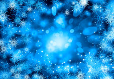 Snowflakes on blue. Background conceptual image with white snowflakes on blue background Stock Image