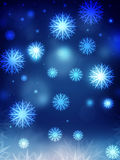 Snowflakes on blue background Stock Photos