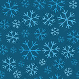 snowflakes on blue background seamless pattern Stock Photography