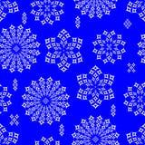 Snowflakes on blue background Stock Photos