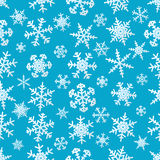 Snowflakes on blue background seamless pattern Stock Photos