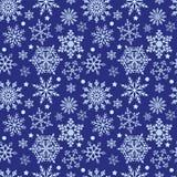 Snowflakes on blue background seamless texture. Winter pattern with snowflakes on a blue background. Vector, seamless texture Stock Photos