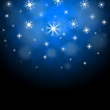 Snowflakes Blue Background Shows Frozen Shiny Stars Royalty Free Stock Photography