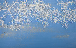Snowflakes on a blue background Stock Image