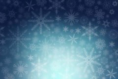 Snowflakes on a blue background. Winter: dancing snowflakes on a blue background Stock Photo