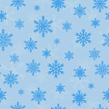 Snowflakes on blue sky - Christmas seamless pattern Stock Images