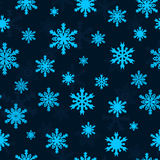 Snowflakes on blue sky - Christmas seamless pattern Royalty Free Stock Images