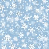 Snowflakes on blue sky, snowstorm - Christmas seamless background Stock Photos
